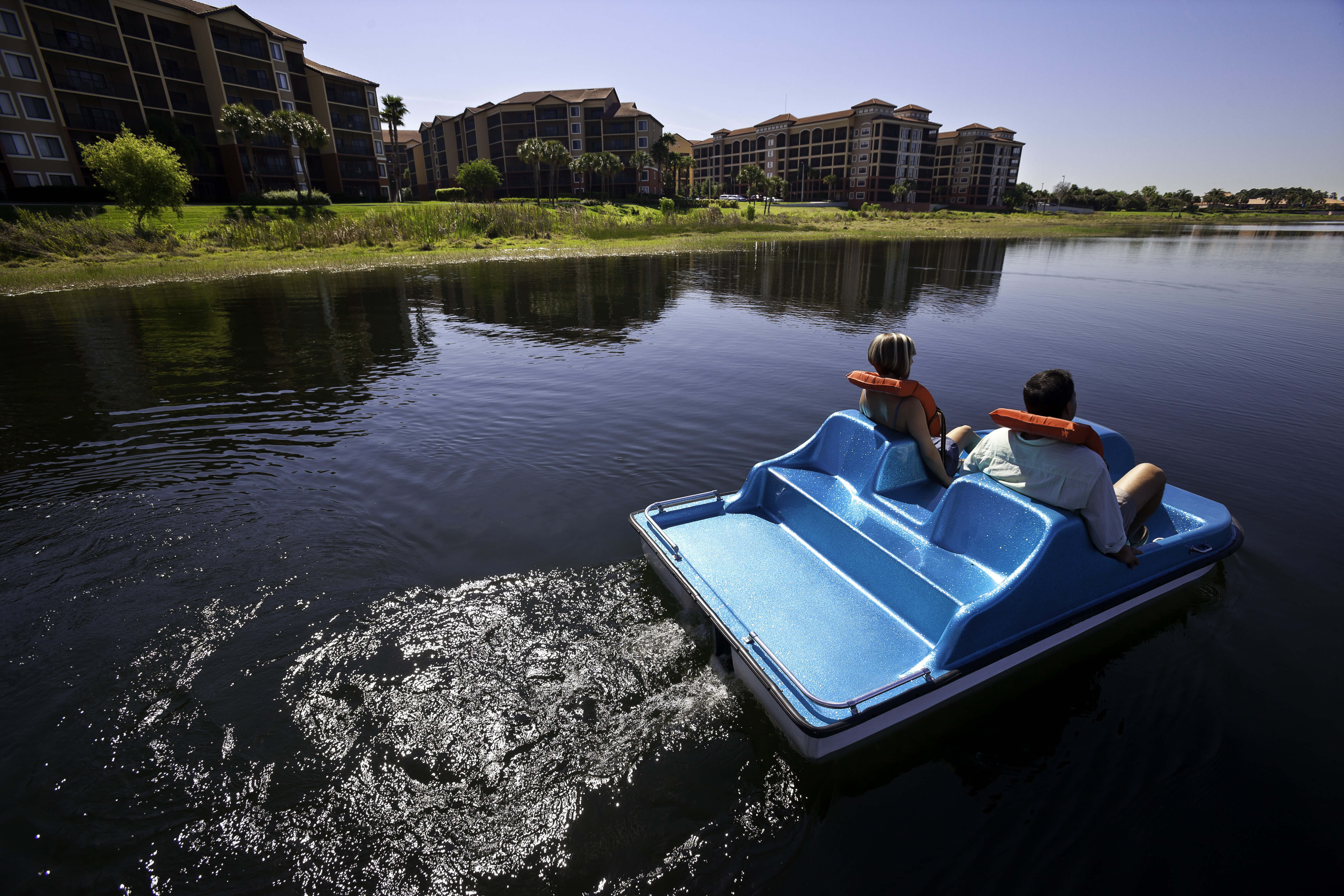 Couple on Paddleboat | Westgate Lakes Resort & Spa | Westgate Resorts