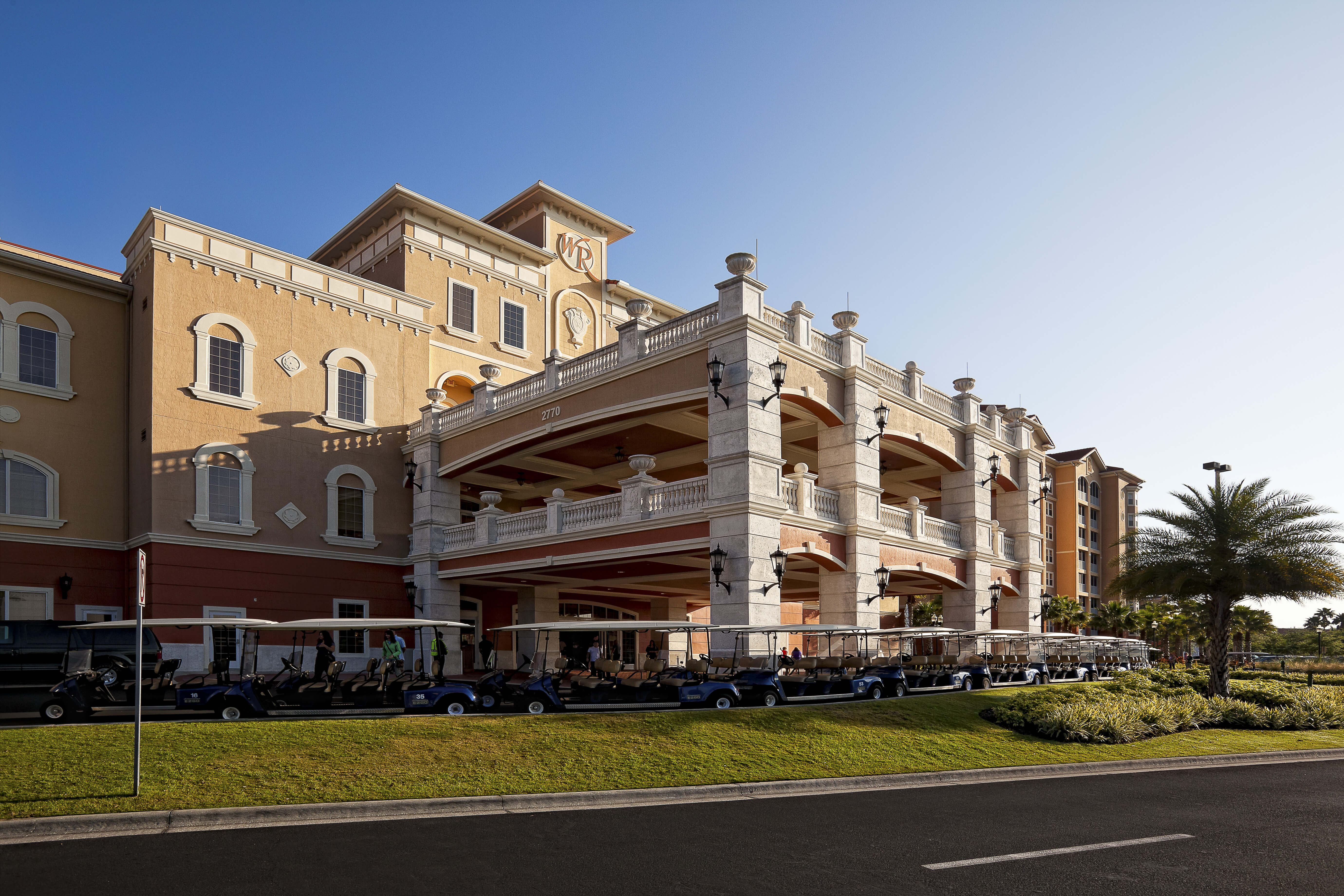 Main entrance to resort with parked golf carts | Westgate Town Center Resort & Spa