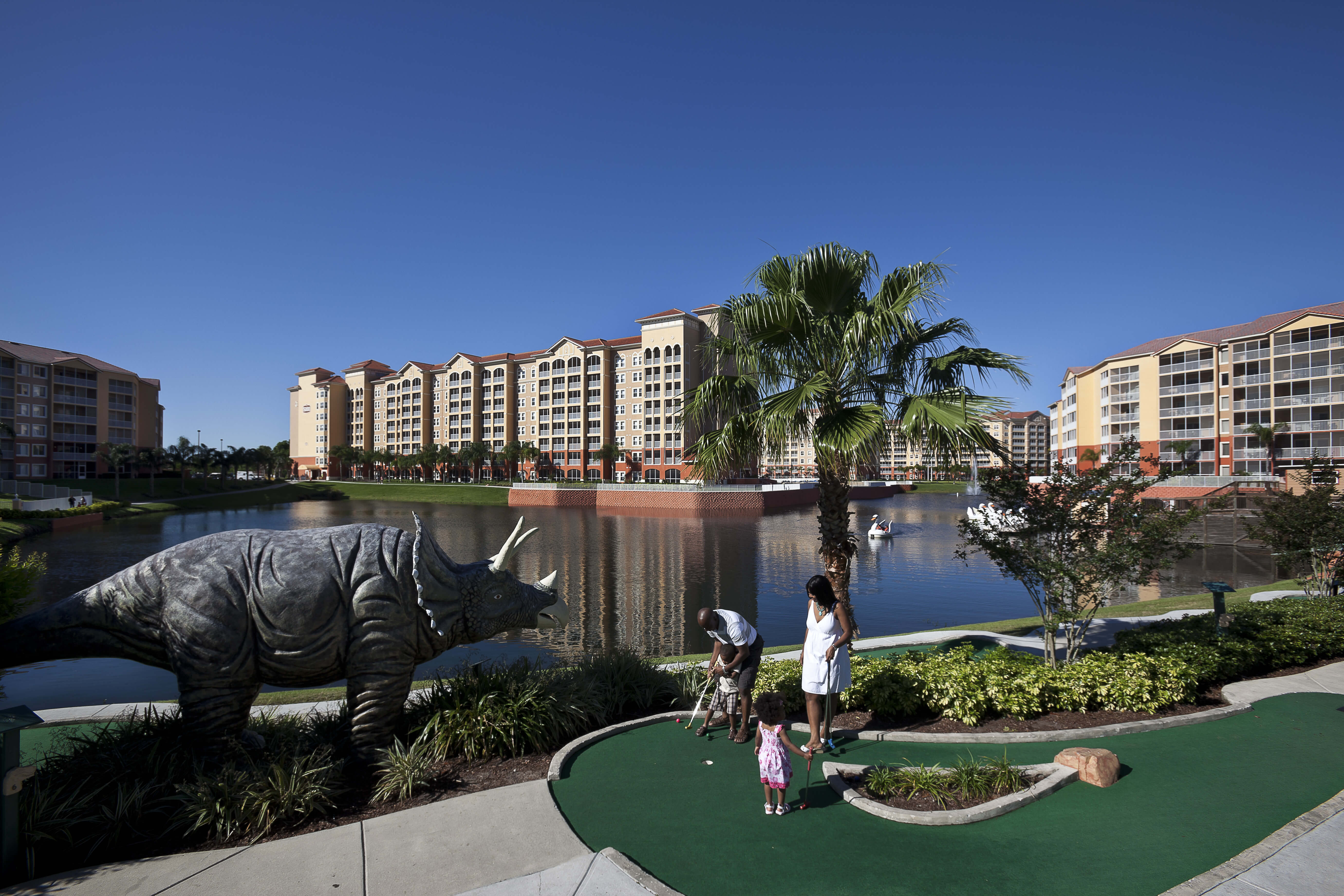 Family Playing Mini Golf | Westgate Town Center Resort & Spa | Westgate Resorts