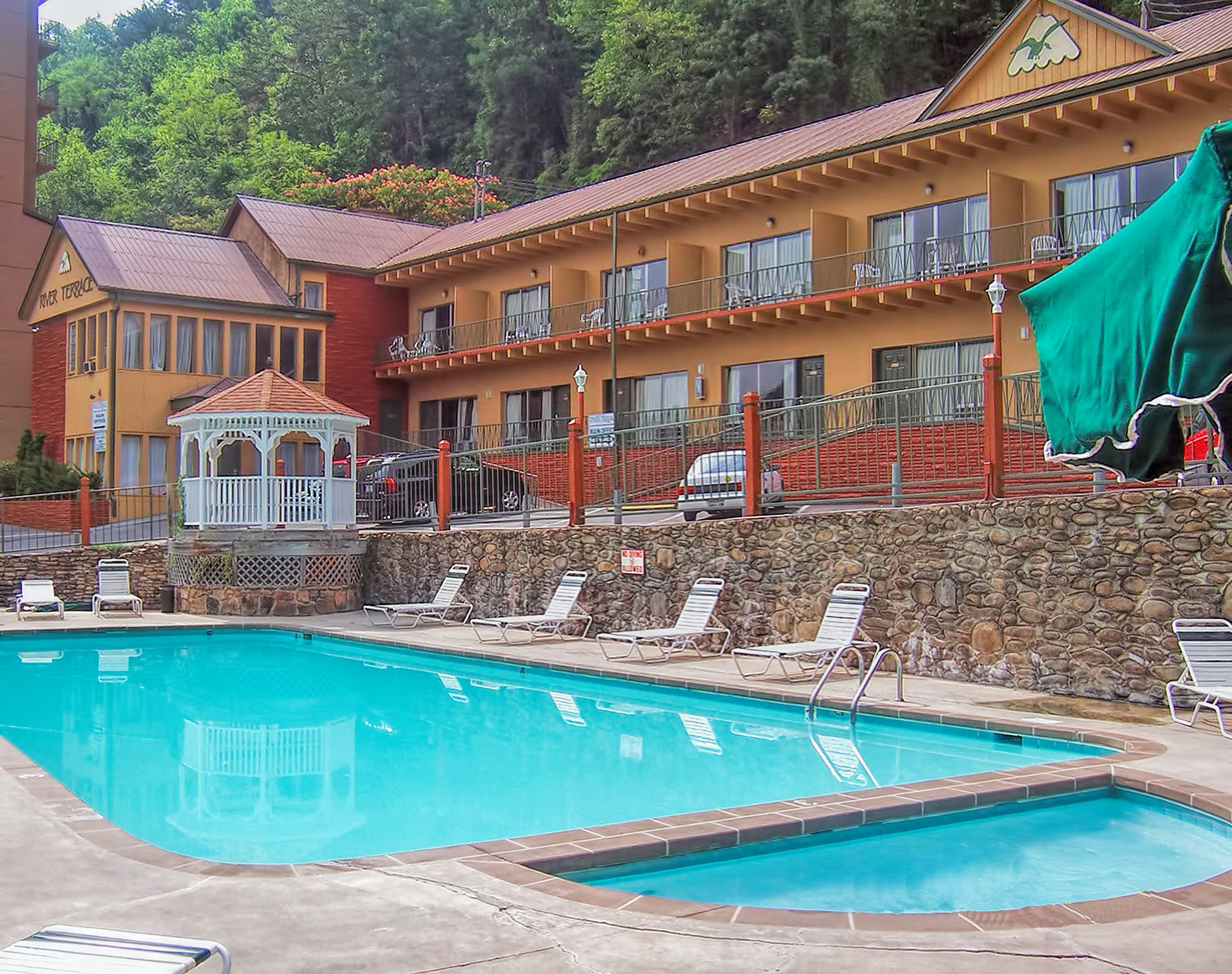 Heated outdoor pool with lounge chairs and gazebo | River Terrace Resort & Convention Center
