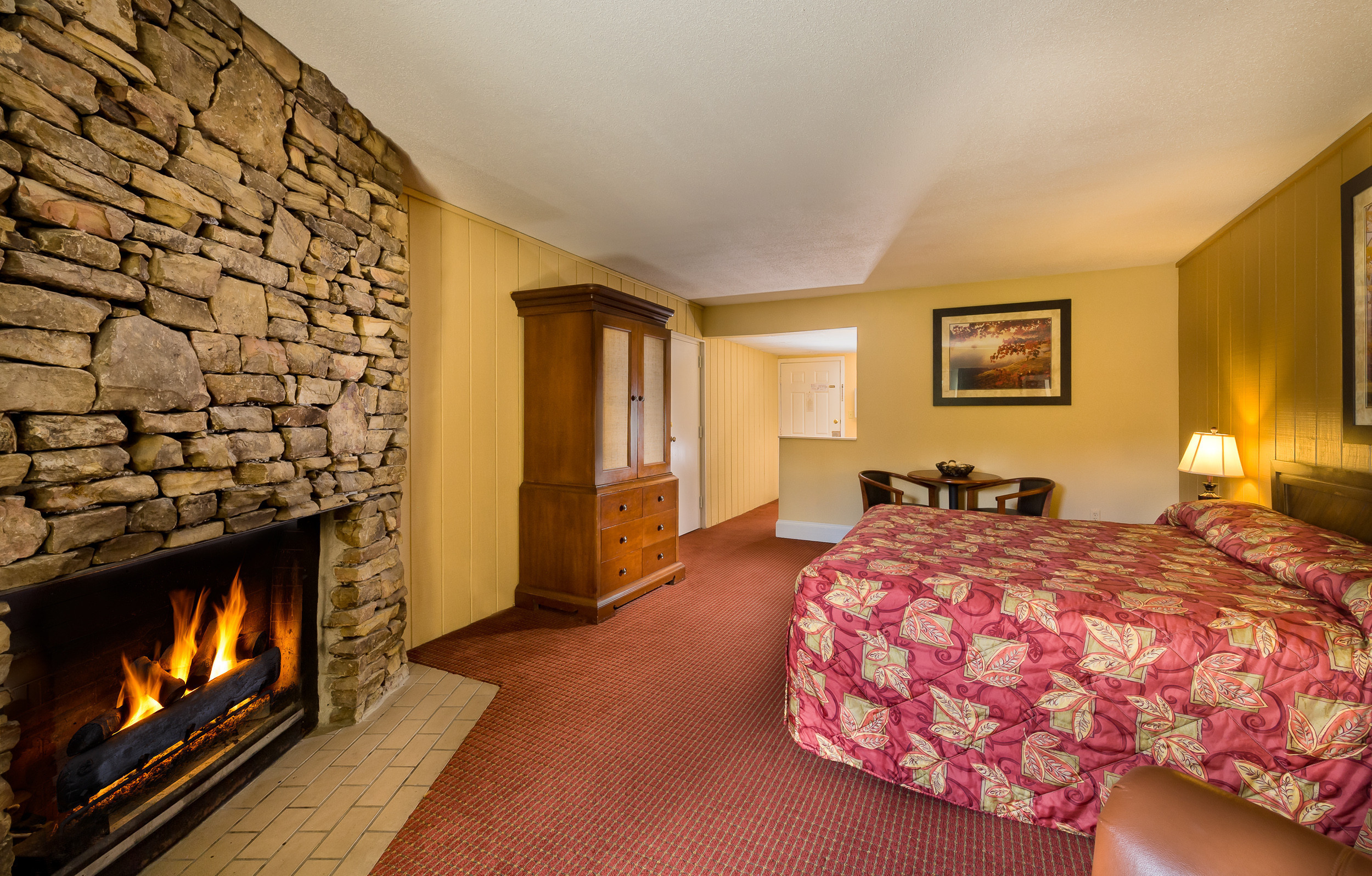 Fireplace and King Bed in Standard King Room | River Terrace Resort & Convention Center