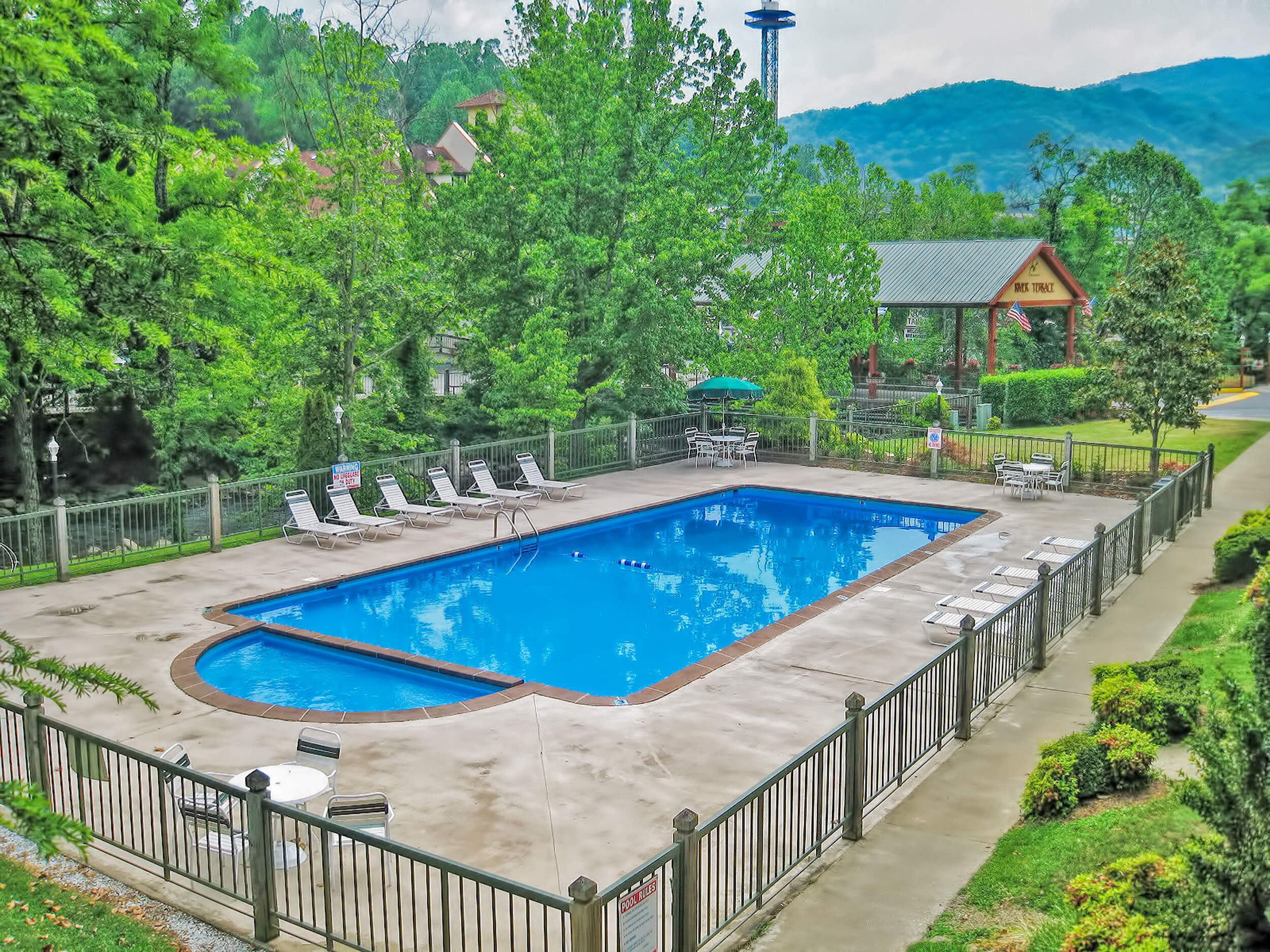 Heated outdoor pool with lounge chairs | River Terrace Resort & Convention Center