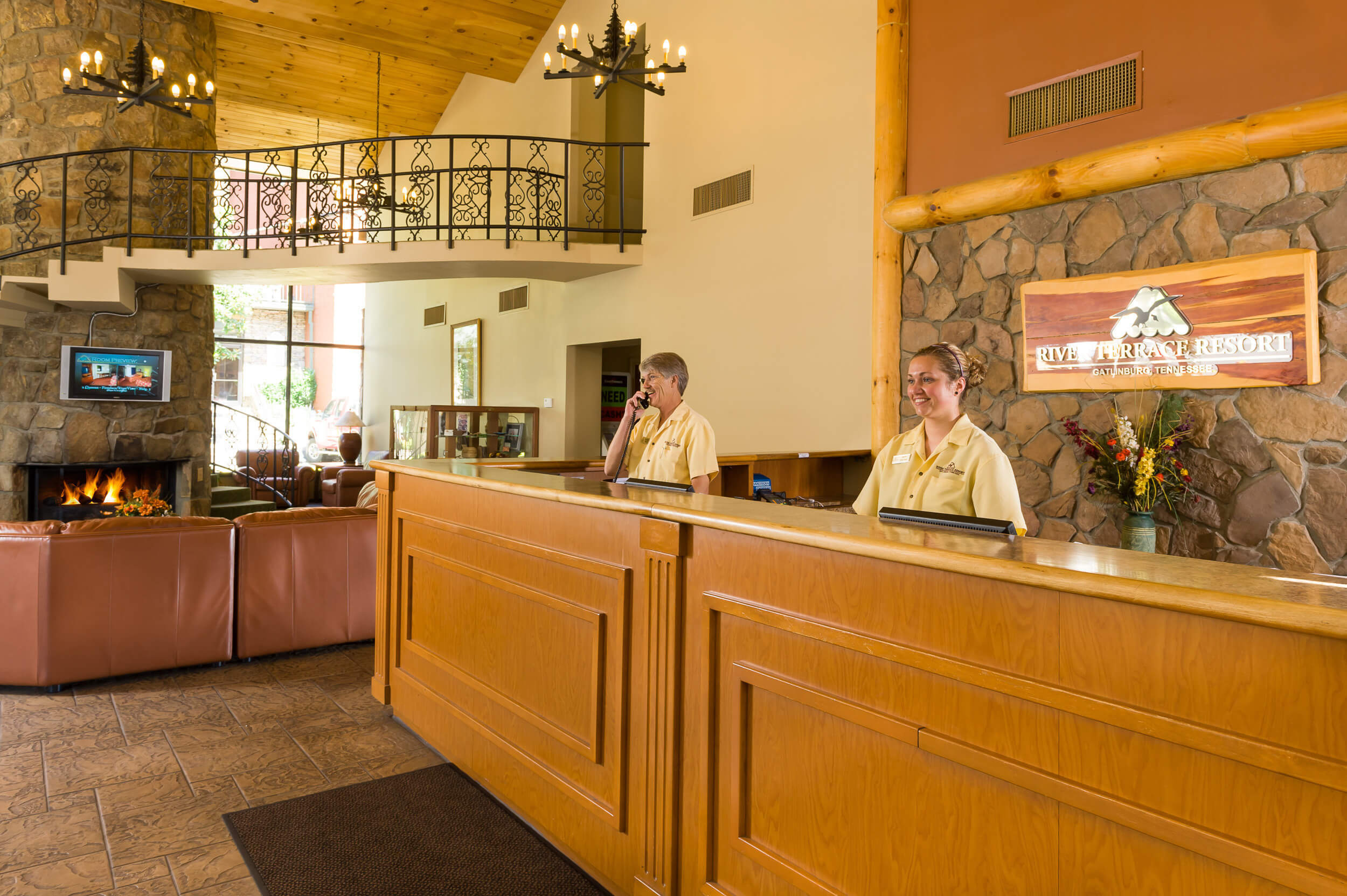 Lobby with front desk and fireplace at our Gatlinburg convention center hotel | River Terrace Resort & Convention Center | Westgate Resorts