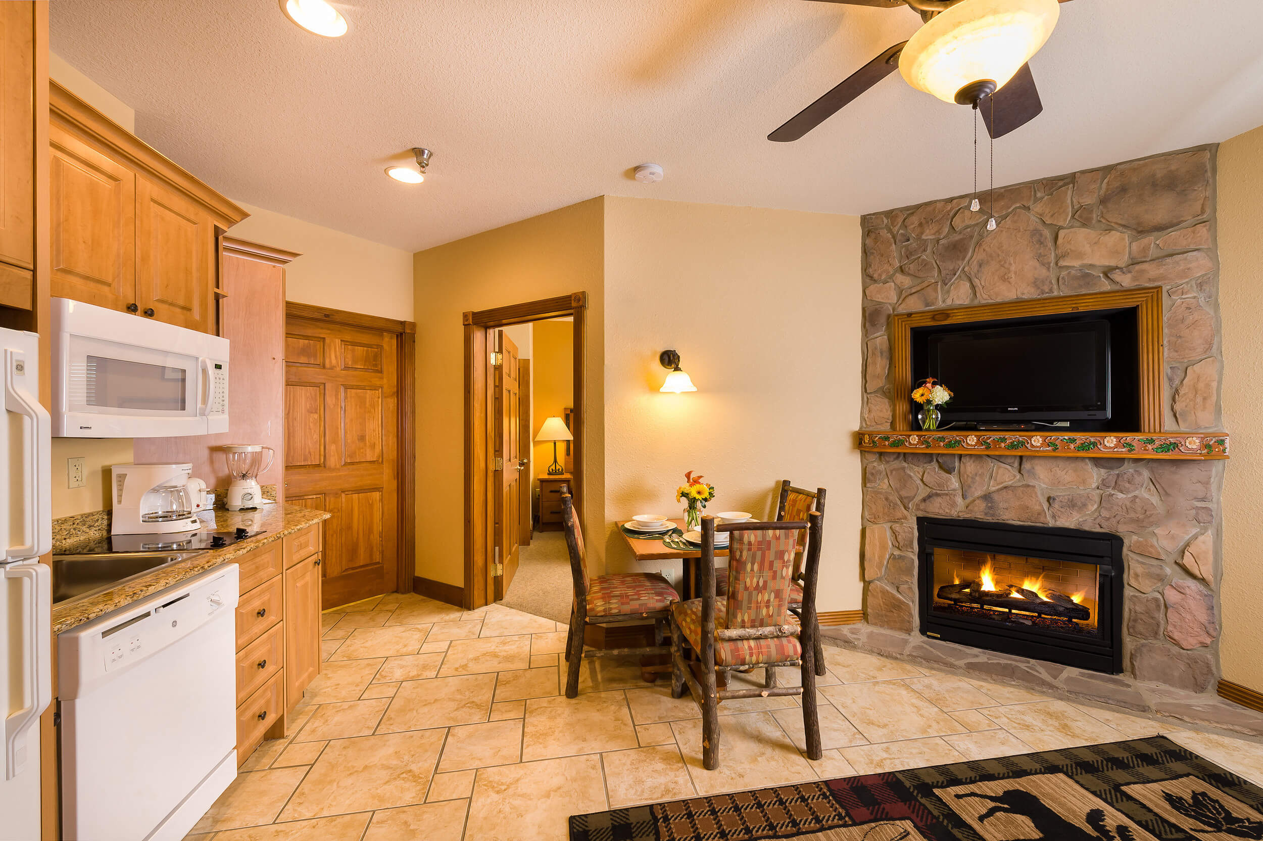 Kitchen and dining area with fireplace | Westgate Smoky Mountain Resort & Spa