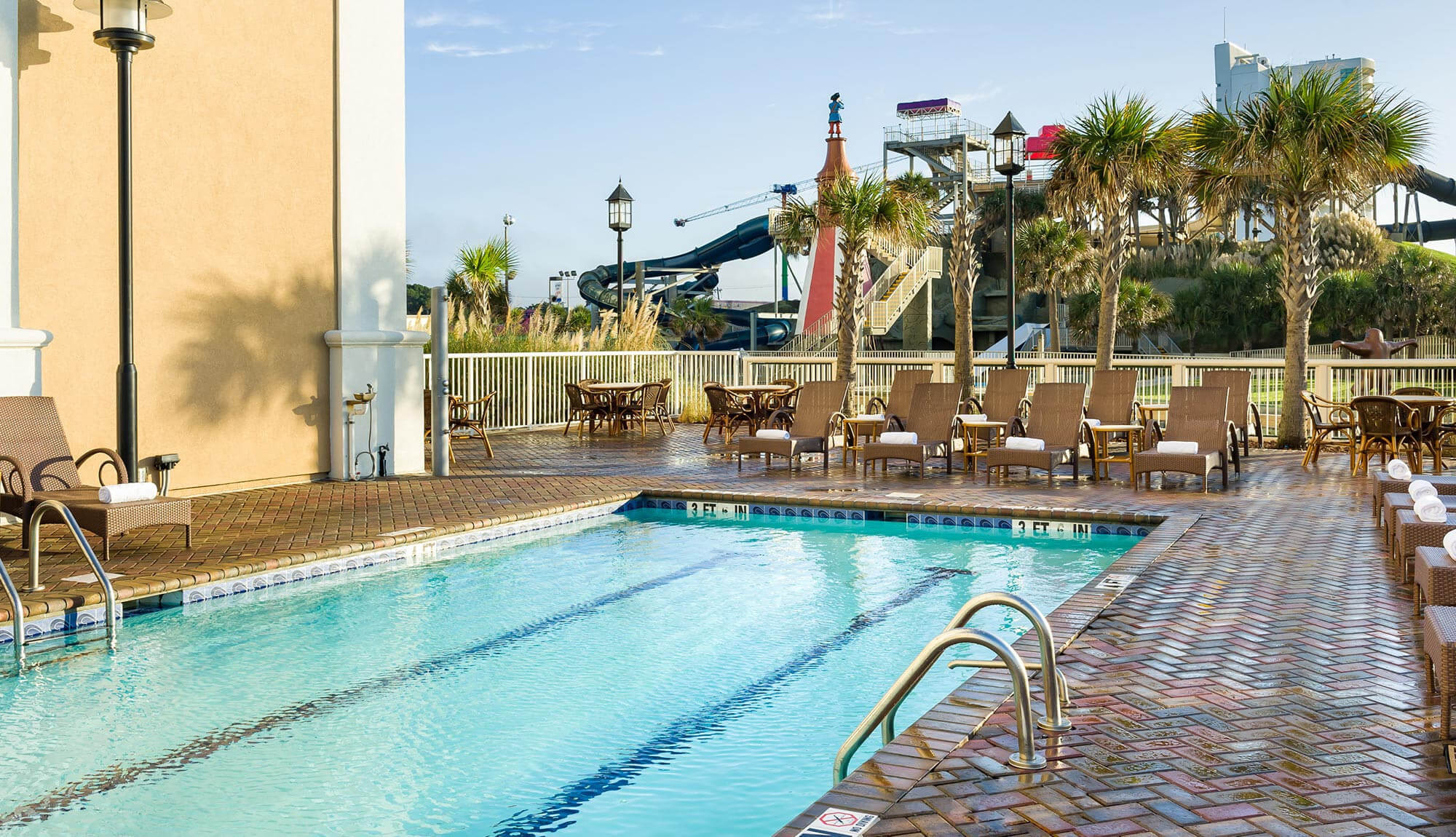 Lap pool with Family Kingdom Amusement Park in background | Westgate Myrtle Beach Oceanfront Resort
