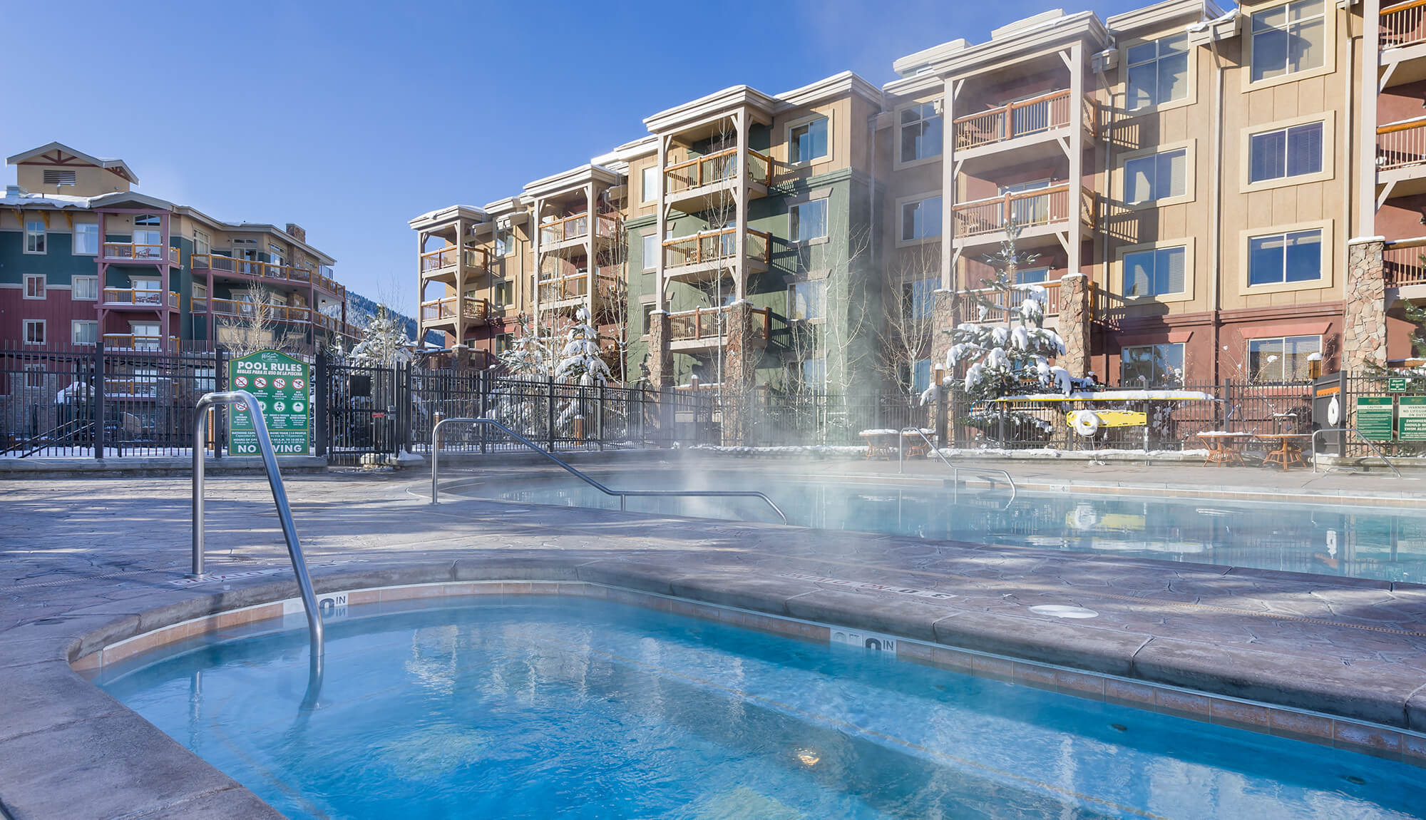 Steam rising from outdoor pool surrounded by snow | Westgate Park City Resort & Spa