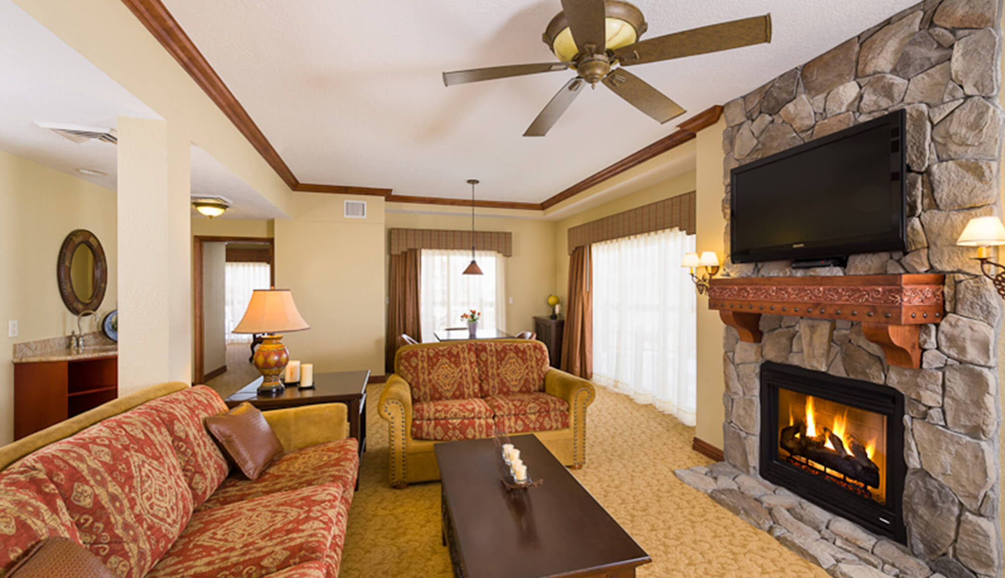 Living Area with fireplace and flat-screen TV in Luxury Four-Bedroom Villa | Westgate Park City Resort & Spa