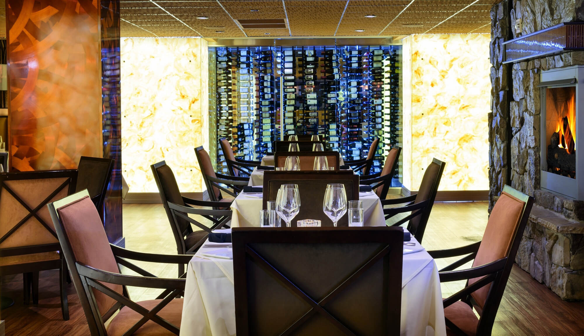 Upscale steakhouse elegantly decorated with wine rack in background | Westgate Park City Resort & Spa