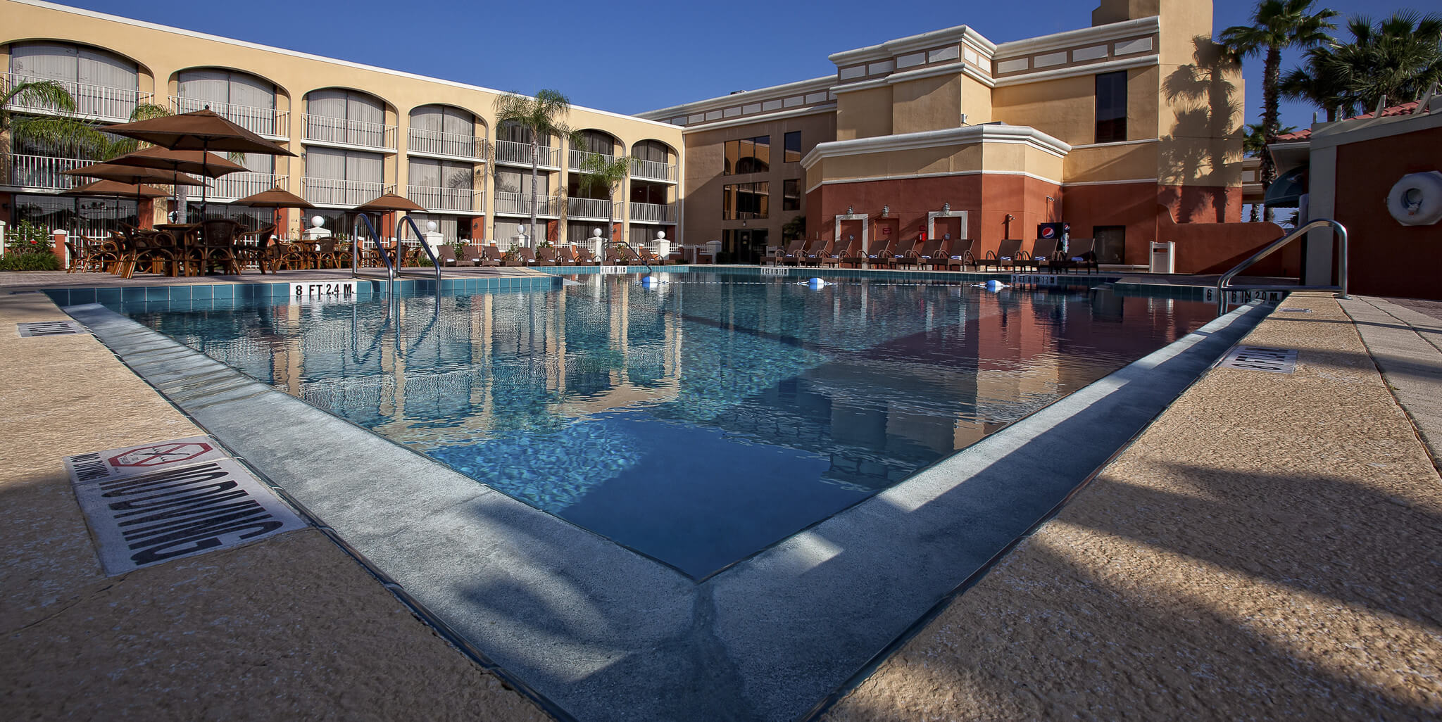 Heated Outdoor Pool Surrounded By Villas At Our Hotel Resorts In Kissimmee Fl Westgate