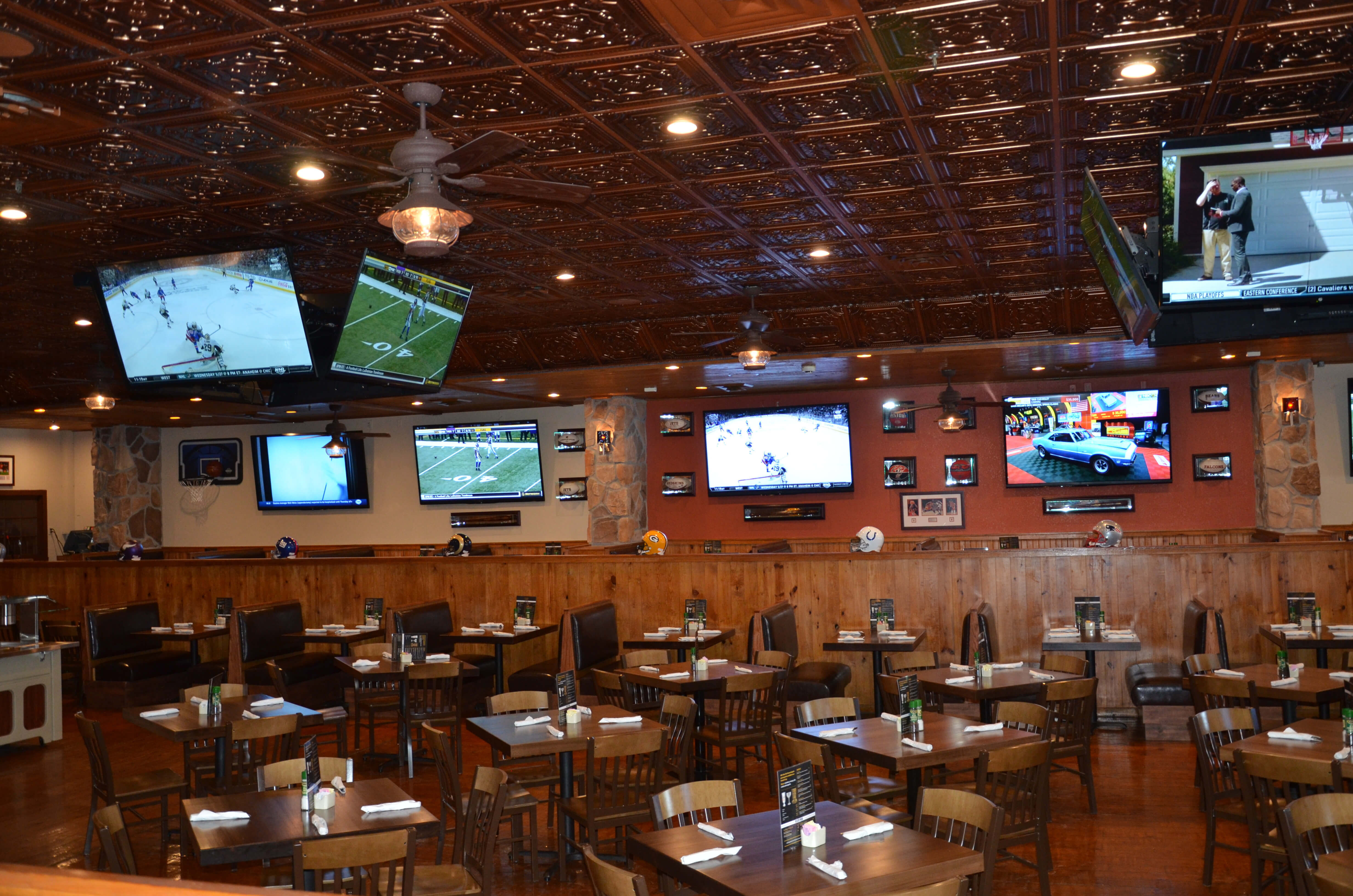 Dining Room at Drafts Sports Grill with multiple flat-screen TVs | Westgate Branson Woods Resort