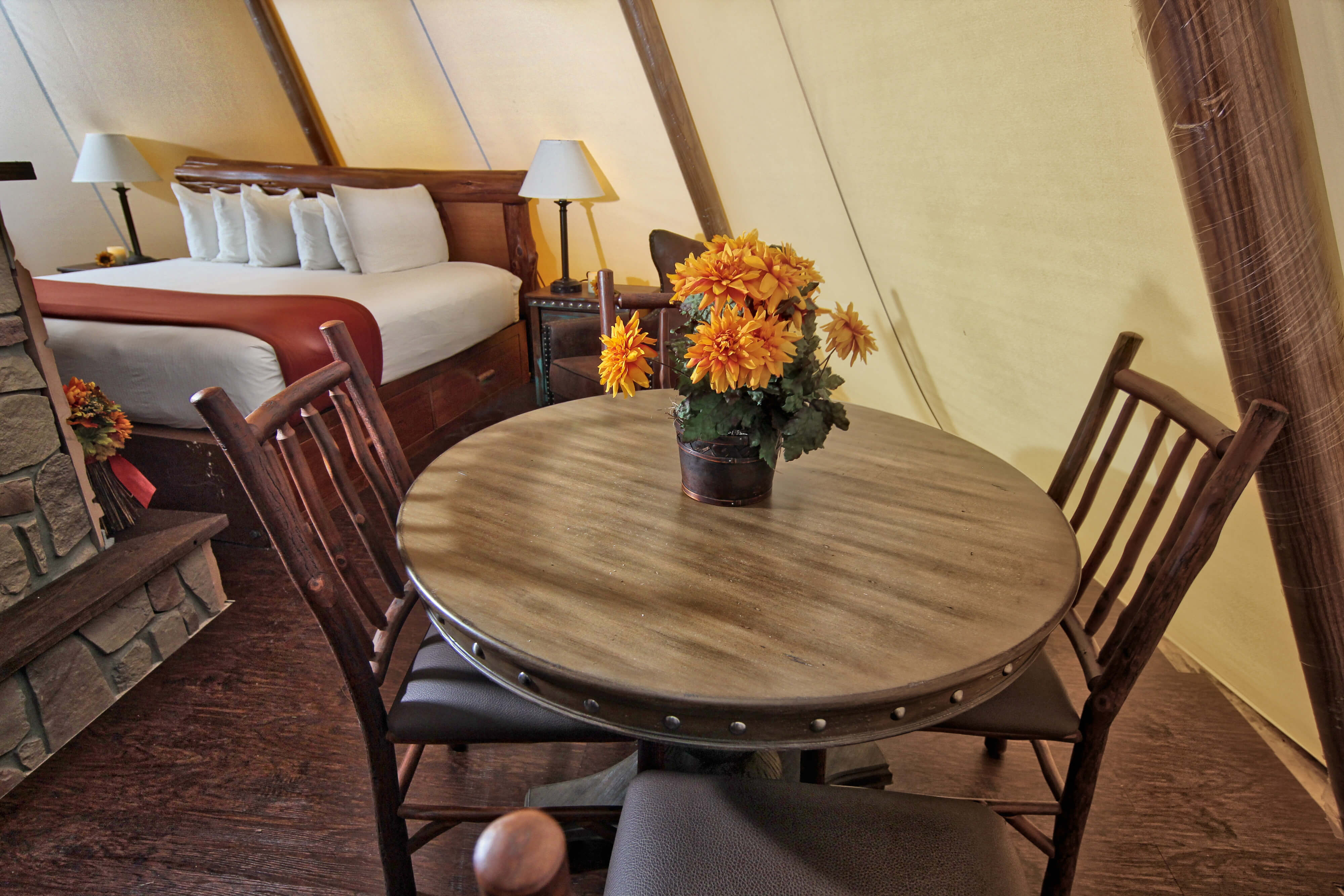 Interior of Luxe Teepee with tables, chairs and king bed | Westgate River Ranch Resort & Rodeo
