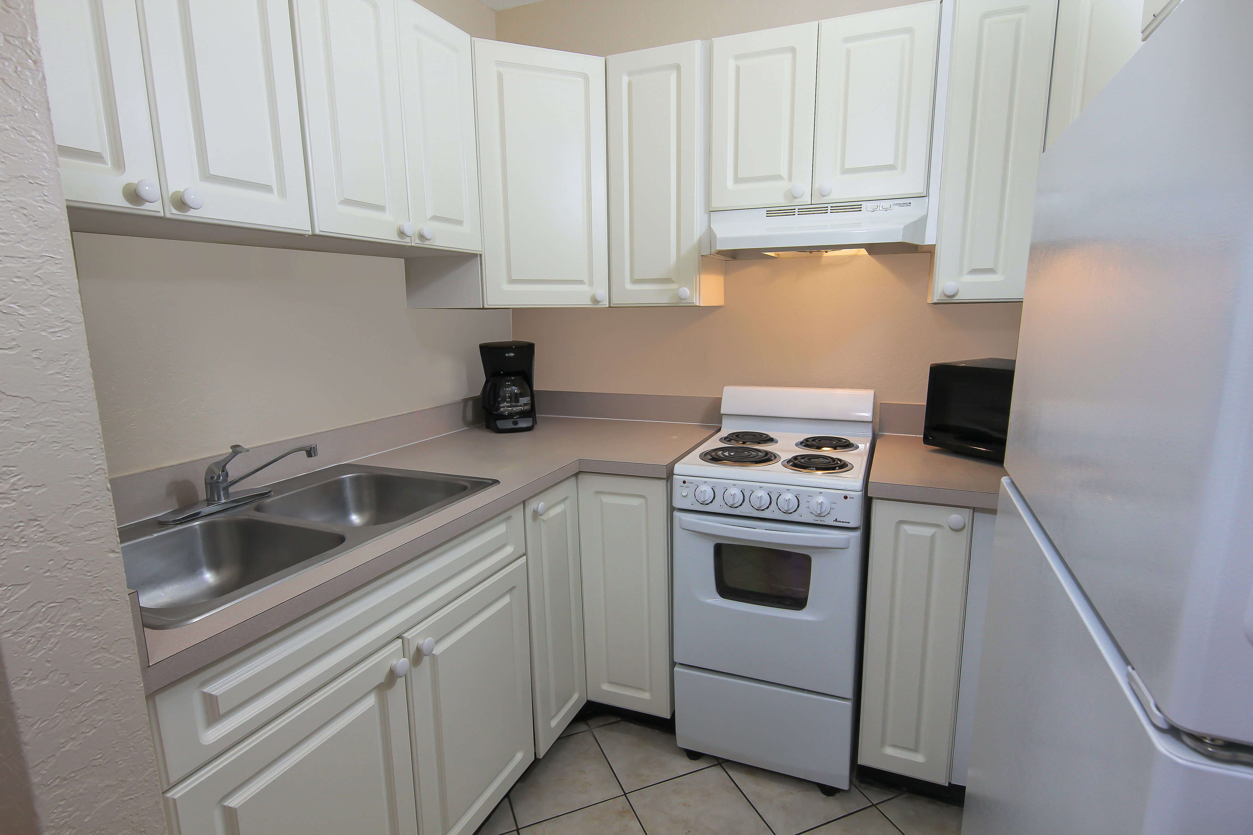 Kitchen in Two Bedroom Beachside Villa in our 2 Bedroom Suites in Cocoa Beach | Wakulla Suites A Westgate Resort | Westgate Resorts