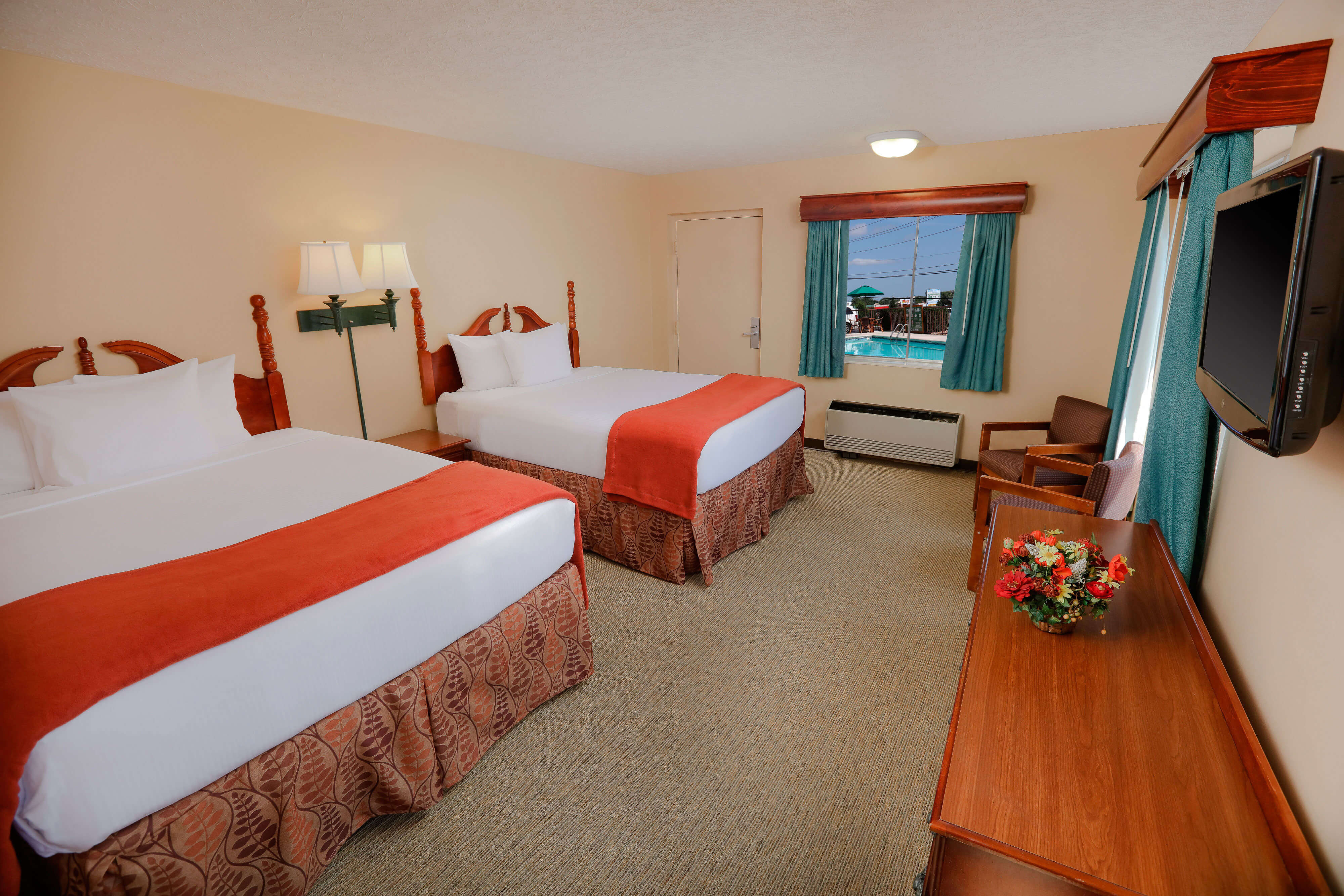 Double Queen Poolside Guestroom at one of our Pigeon Forge Resorts | Wild Bear Inn | Westgate Resorts in the Smoky Mountains