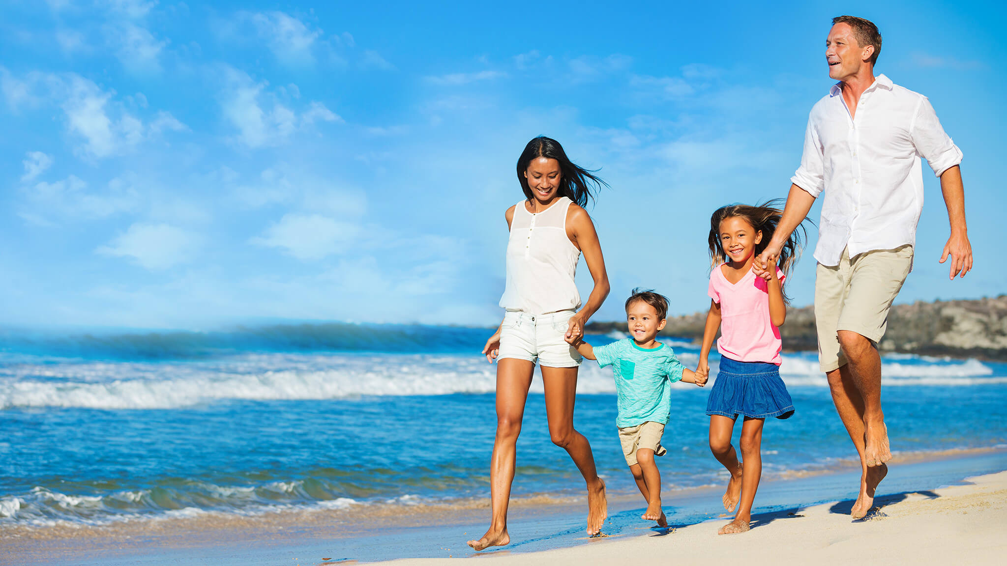 Family strolling on beach along Grand Strand   Westgate Myrtle Beach Oceanfront Resort