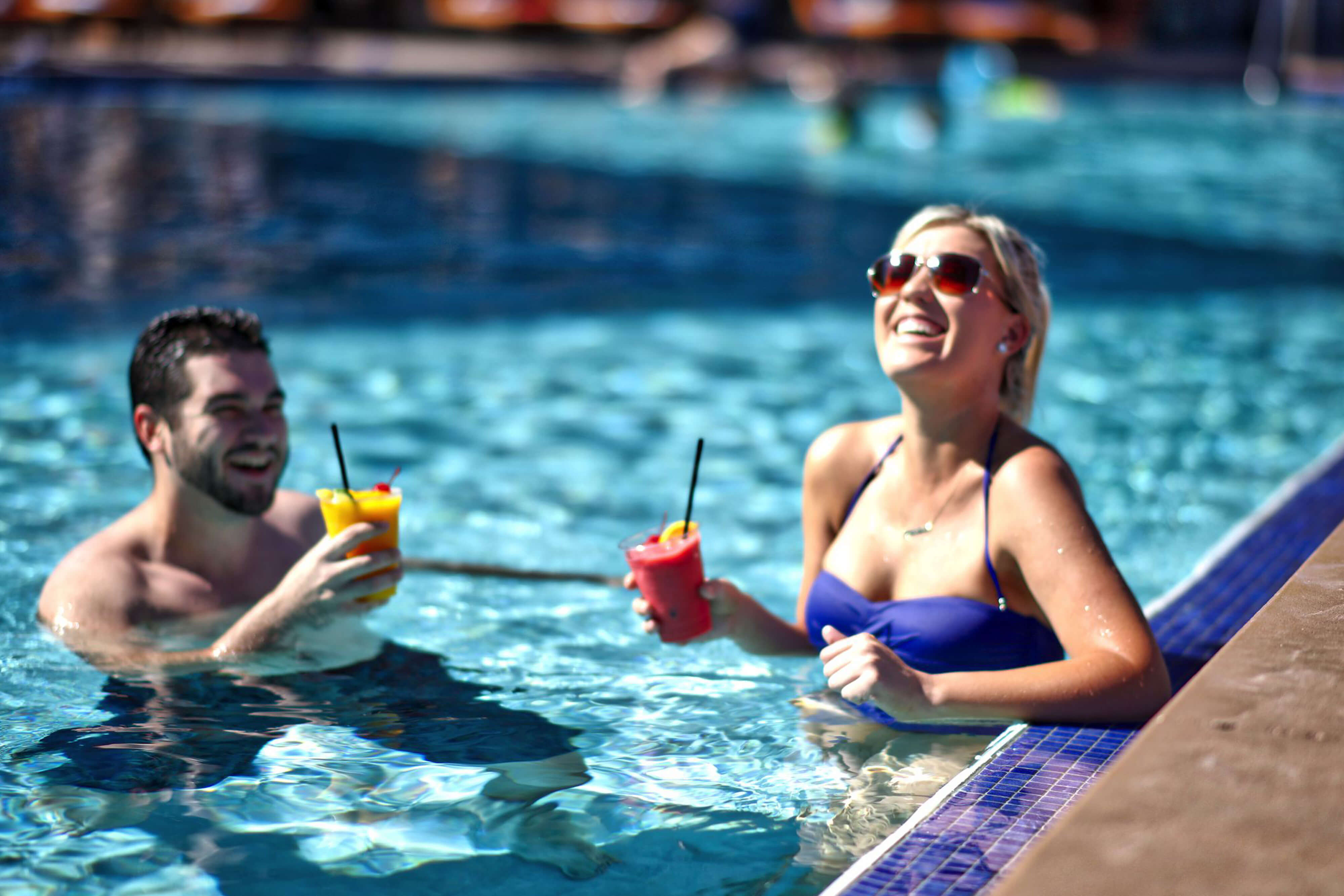 Couple Enjoying the Pool | Westgate Palace Resort | Orlando, FL | Westgate Resorts
