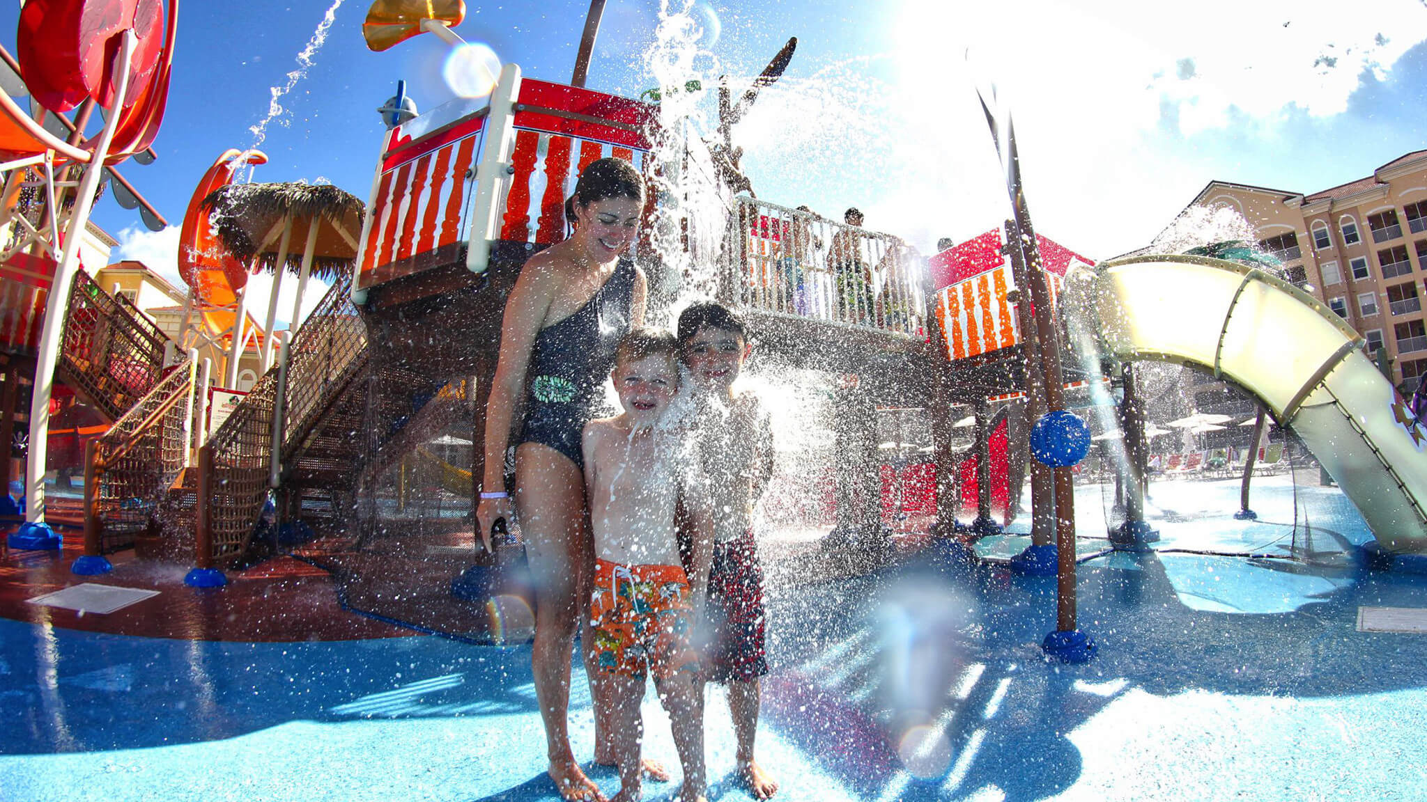 Family enjoys Splash Pad at Ship Wreck Island Water Park | Florida Vacation Villas in Kissimmee | Westgate Vacation Villas Resort & Spa
